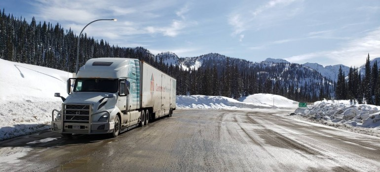 Centennial Moving truck on a road moving from Canada to USA