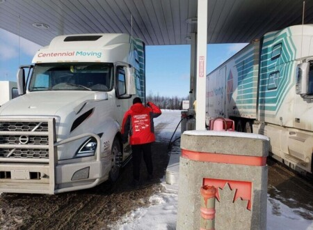 Centennial Moving Professional Moving Service in Canada - Saying Hi to the fellow driver at the crossroads of the country