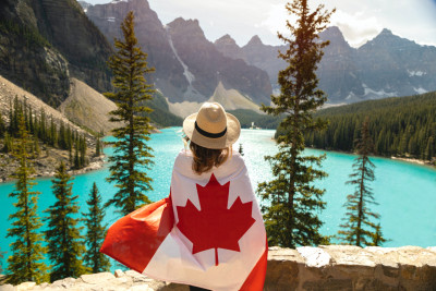 girl wearing Canada flag as a symbol of her move from Vancouver to Toronto in a week