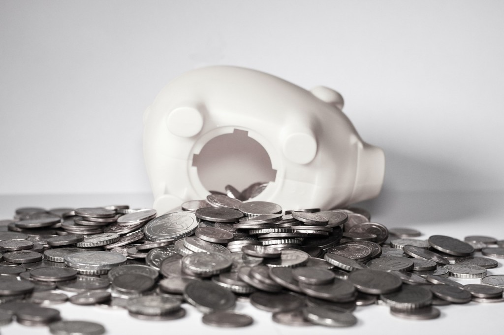 a piggy bank with coins spilling out of it
