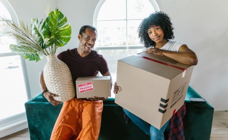 a couple with cardboard boxes