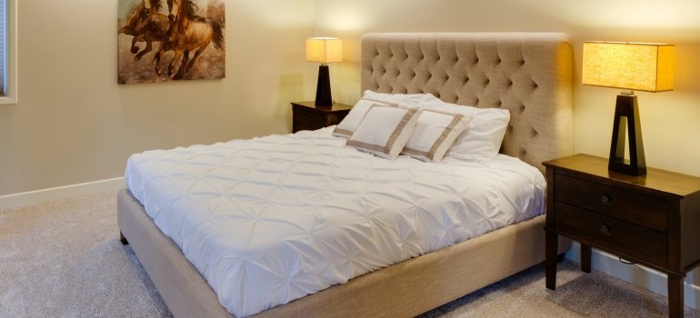 beige king size bed in a bedroom