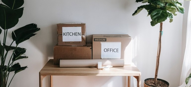 """moving boxes labeled """"kitchen"""" and """"office"""""""