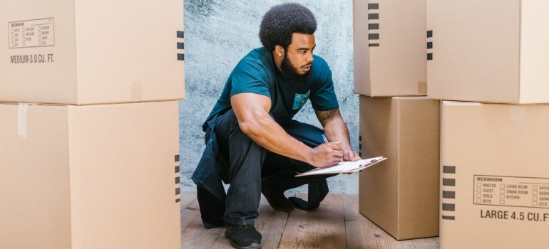 a mover inventorying moving boxes
