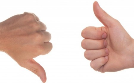 Two hands showing thumbs up and thumbs down