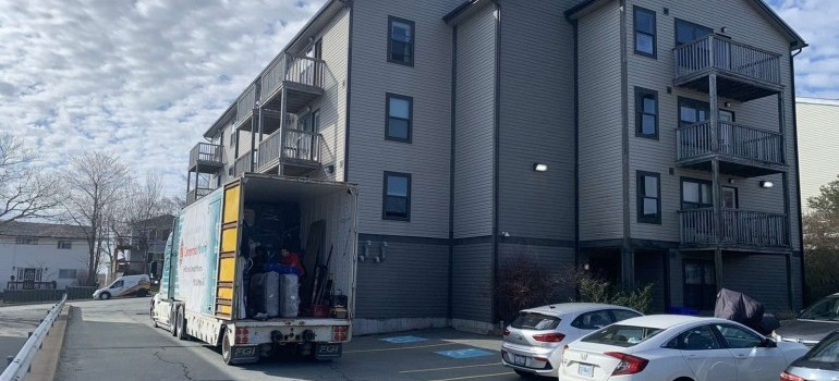 building and Centennial Moving truck ready for moving Toronto to Thunder Bay ON