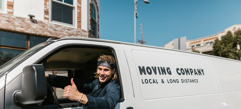 Employee from moving company in Quebec City in his moving van