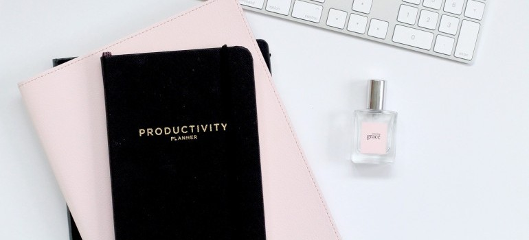 A black productivity planner on the table.